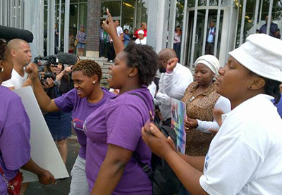 Activists celebrate Andile Ngcoza's 22 year sentence outside the Wynberg Magistrate's Court on Tuesday