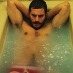 50 SHADES STAR WOWS IN SHIRTLESS PICS
