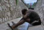 A homeless youth from the LGBT community sits in the sewer where he lives in Kingston, Jamaica. (Pic: (C) 2014 Human Rights Watch)
