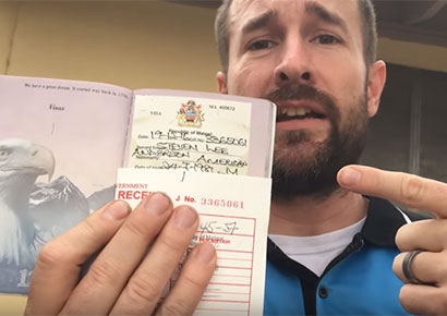 Anderson holds up his Malawi visa