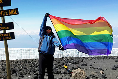 Herbie Aucamp holds the rainbow flag over the roof of Africa