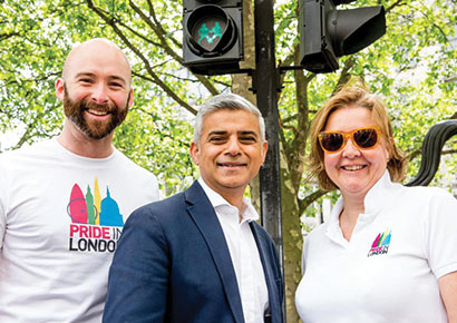 Mayor Sadiq Khan (centre) with Pride's Michael Salter-Church and Alison Camps